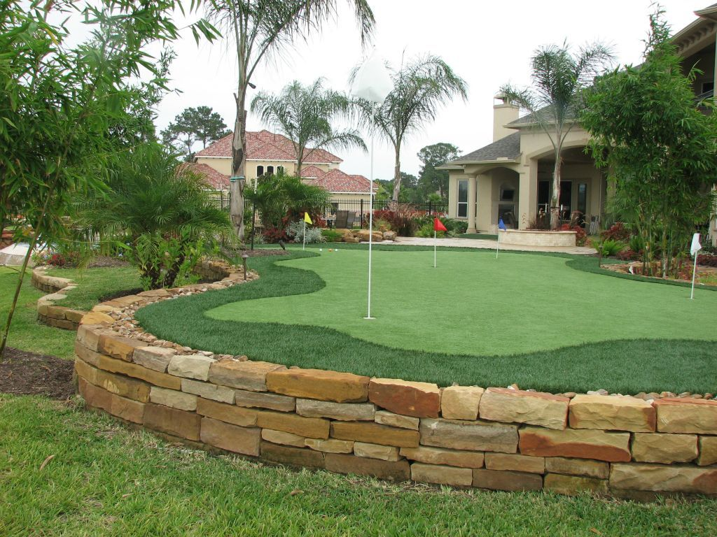 traditional landscape yard with backyard golf cage fence dave