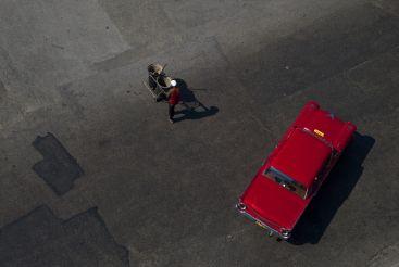 by Alison McCauley / Red car, Havana, Cuba, 2012