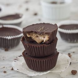 Decadent and rich dark chocolate almond butter cups filled with creamy almond butter and topped with crunchy smoked sea salt.