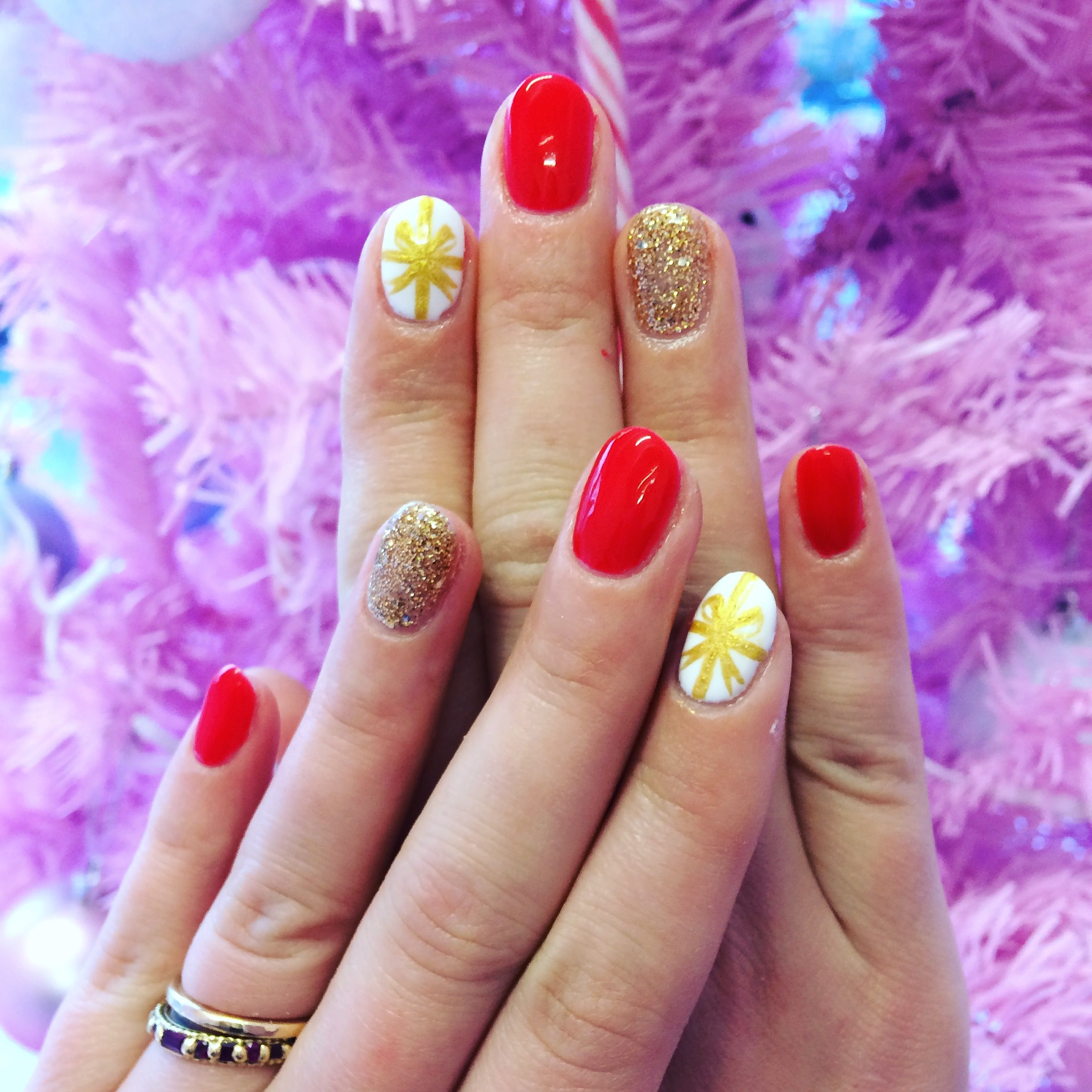Glitter and red with gift wrapped Christmas nail art | Our Nails ...