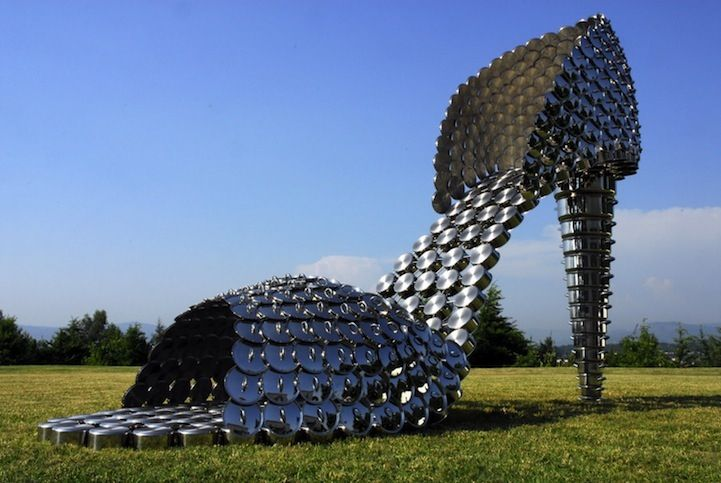 Actual shoe sculpture but not for the feet or Shoes for very big feet! Giant Shoes made from Pots, Pans & Lids By Joana Vasconcelos.