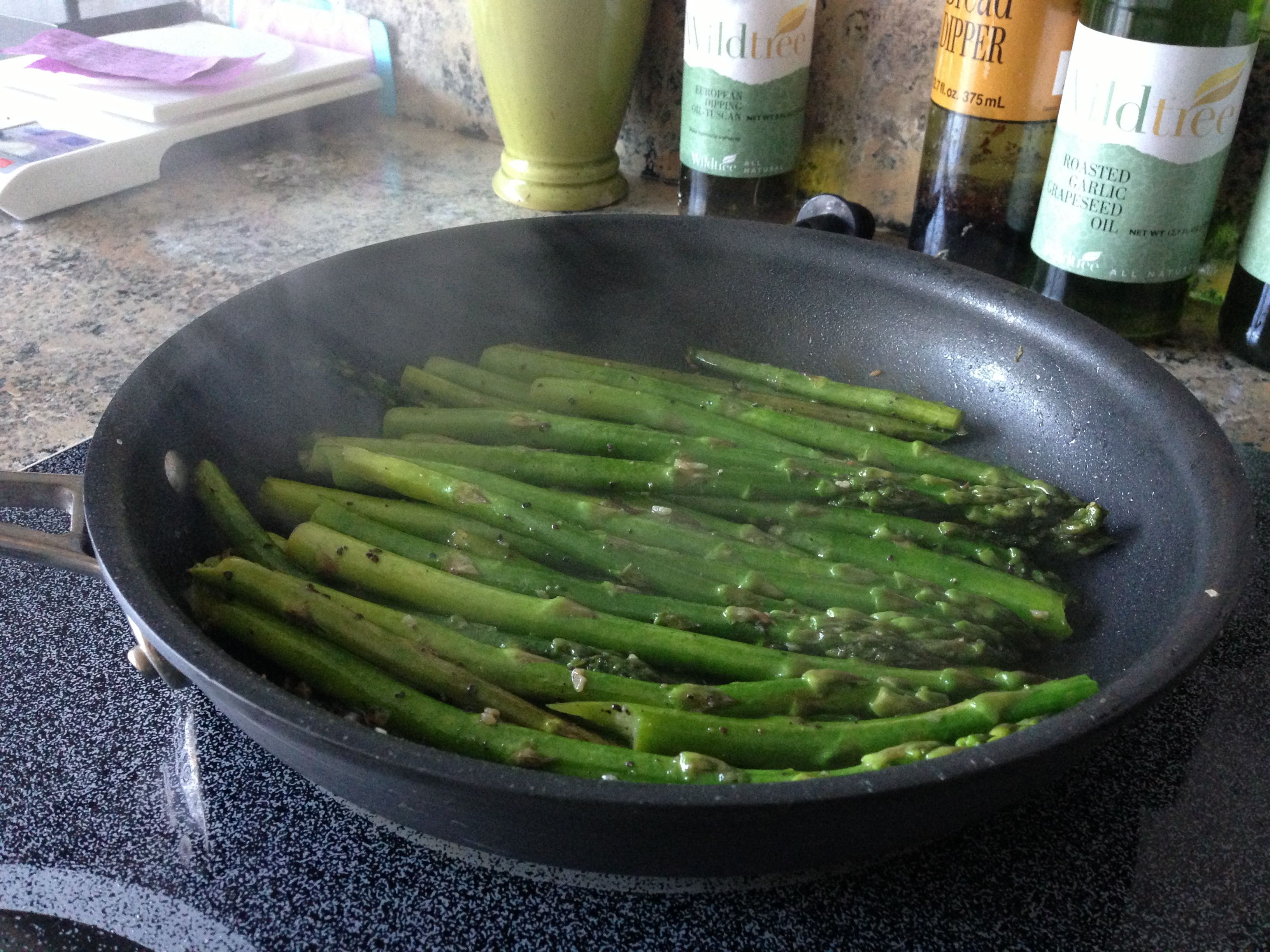 Asparagus sautéed with Wildtree Roasted Garlic Grapeseed Oil and Wildtree Rancher Steak Rub. Even My 2 year old ate this and asked for seconds! Get these ingredients now at:  Www.mywildtree.com/kellyolin
