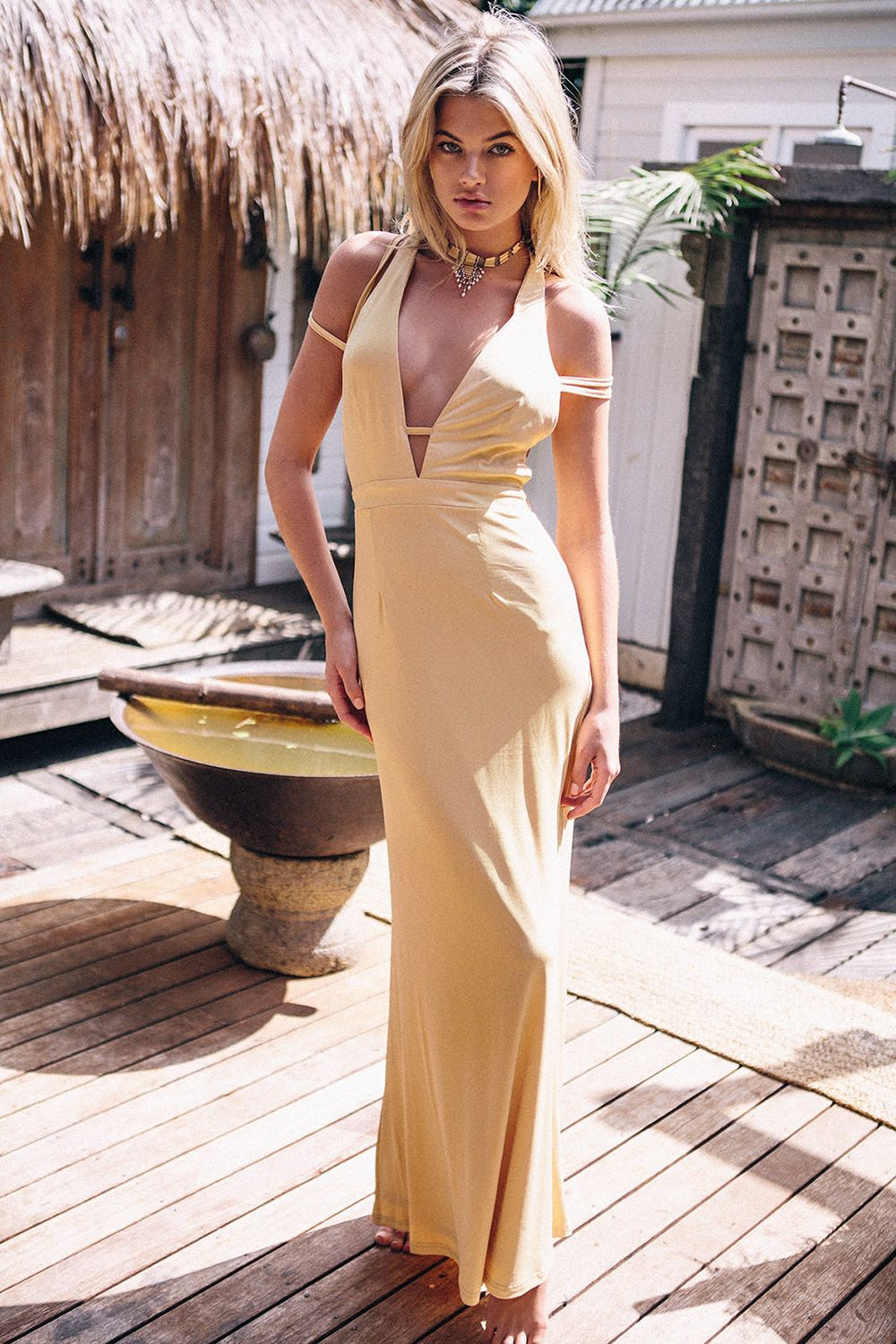 Made from a slinky fabric in a pastel mustard hue the striking