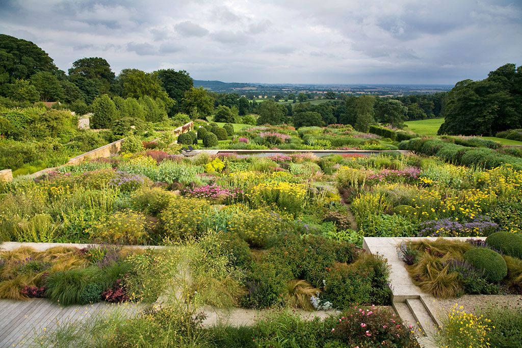 Credit: Andrew Lawson Mount St John, Yorkshire designed by Tom Stuart-Smith. Here the big views are complemented by big-scale plantings which bulk up in late summer. Halfway down the slope a lateral pool breaks up the space and invites the visitor in.