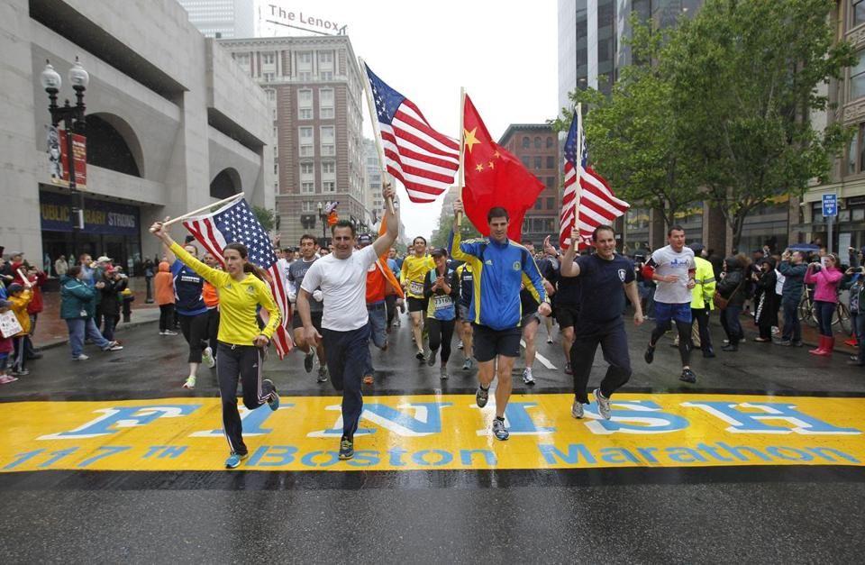 Thousands run Boston Marathon's final mile Boston
