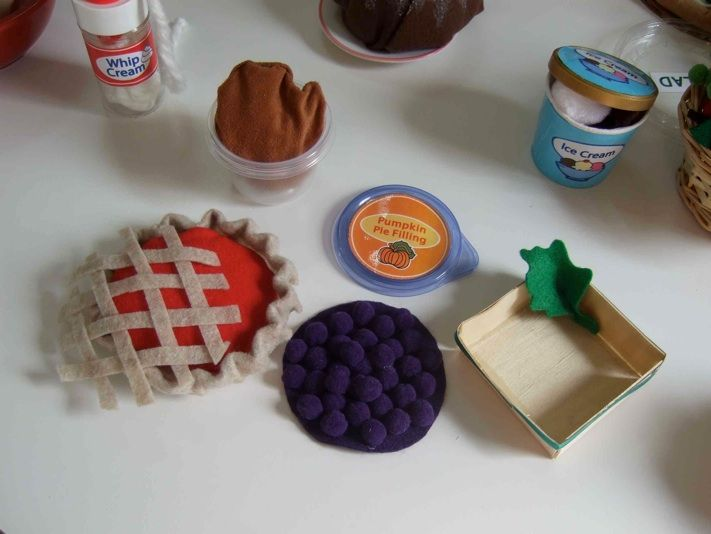 felt pie with many kinds of fillings- I like the berry one with pompoms sewn onto it (I wonder if sewing or glue would be better?)