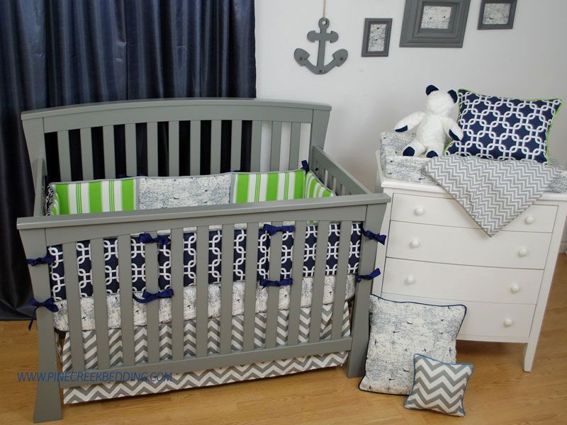 Green Stripe And Navy Geometric Crib Bedding In A Nautical Theme Nursery With Grey Chevron