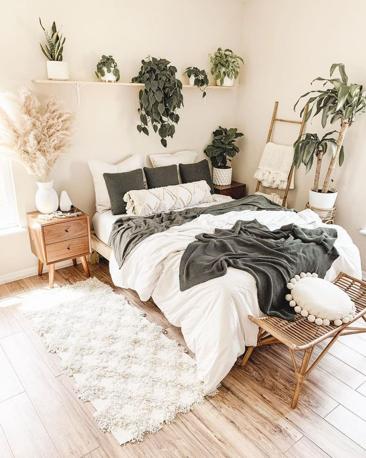White and green bedroom with indoor plants and pam
