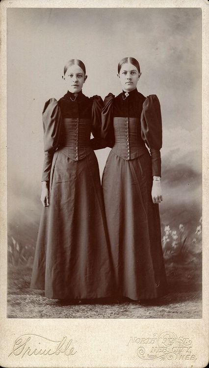 Interesting. I like the buttons down the front of the corsets.