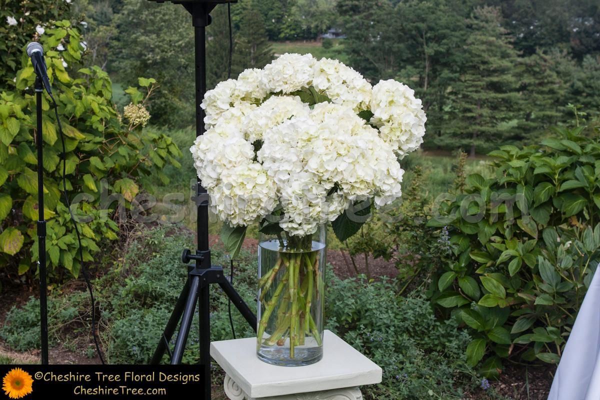 The Ceremony Arrangements Of White Hydrangea In Clear Glass Cylinder