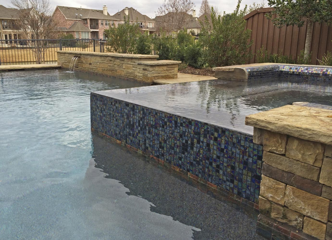 Iridescent Glass Tile Spa With Pebble Sheen And Brass