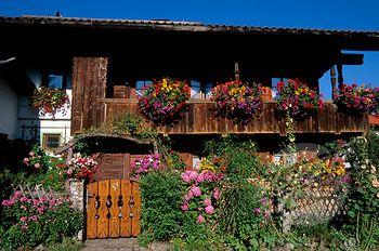 SuperStock - GERMANY, BAVARIA, STARNBERGER SEE (LAKE), BERNRIED, OLD WOODEN HOUSE, BUILT 1685, FLOWERS