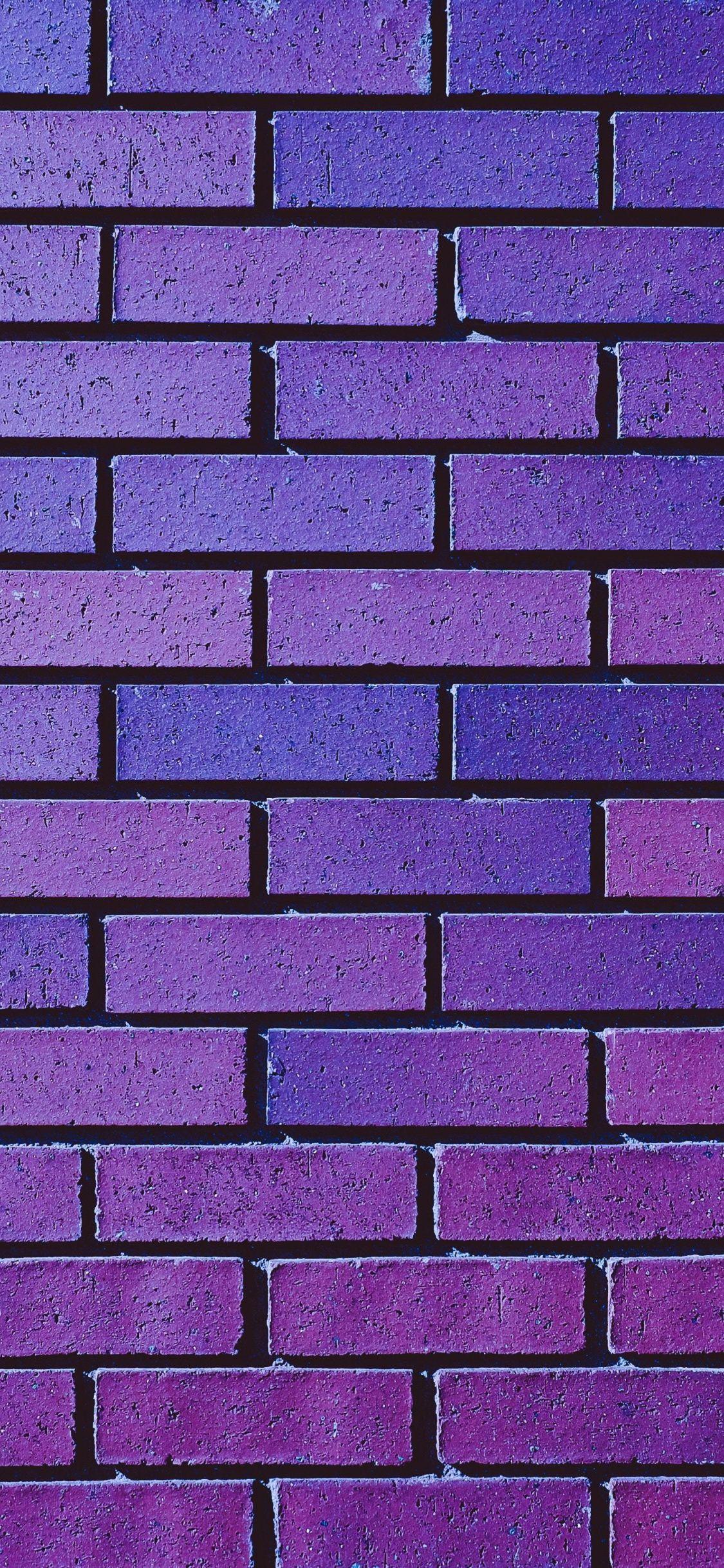 Violet wall, bricks, pattern, 1125x2436 wallpaper