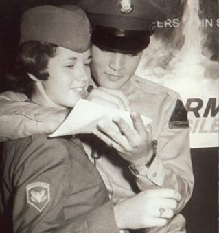 THE MOST UNUSUAL ELVIS ARTICLES | Photo was taken while Elvis was a Private, but check out the woman's rank. She was a SpecFive, three ranks higher than Elvis, so he had his arm around a superior officer. You can get in trouble for that, right? Well, maybe not, if you're Elvis. She sure doesn't look like she minded.