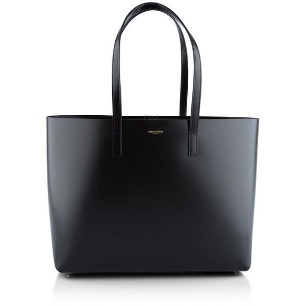Saint Laurent Shopping Tote (1,375 CAD) ❤ liked on Polyvore featuring bags, handbags, tote bags, purses, borse, totes, black hand bags, purse tote, tote hand bags and tote bag purse