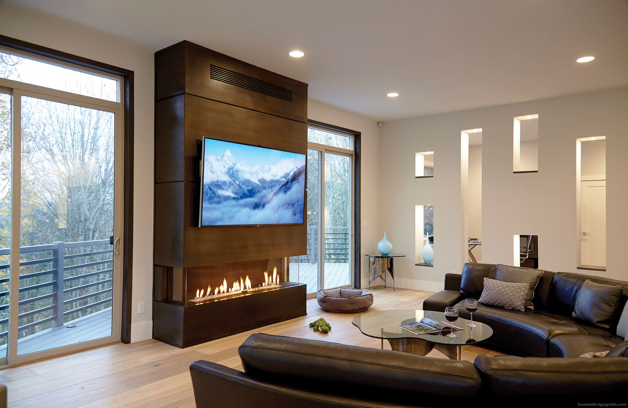 Cozy Living Room Setup With Tv Over The Fireplace Built In O