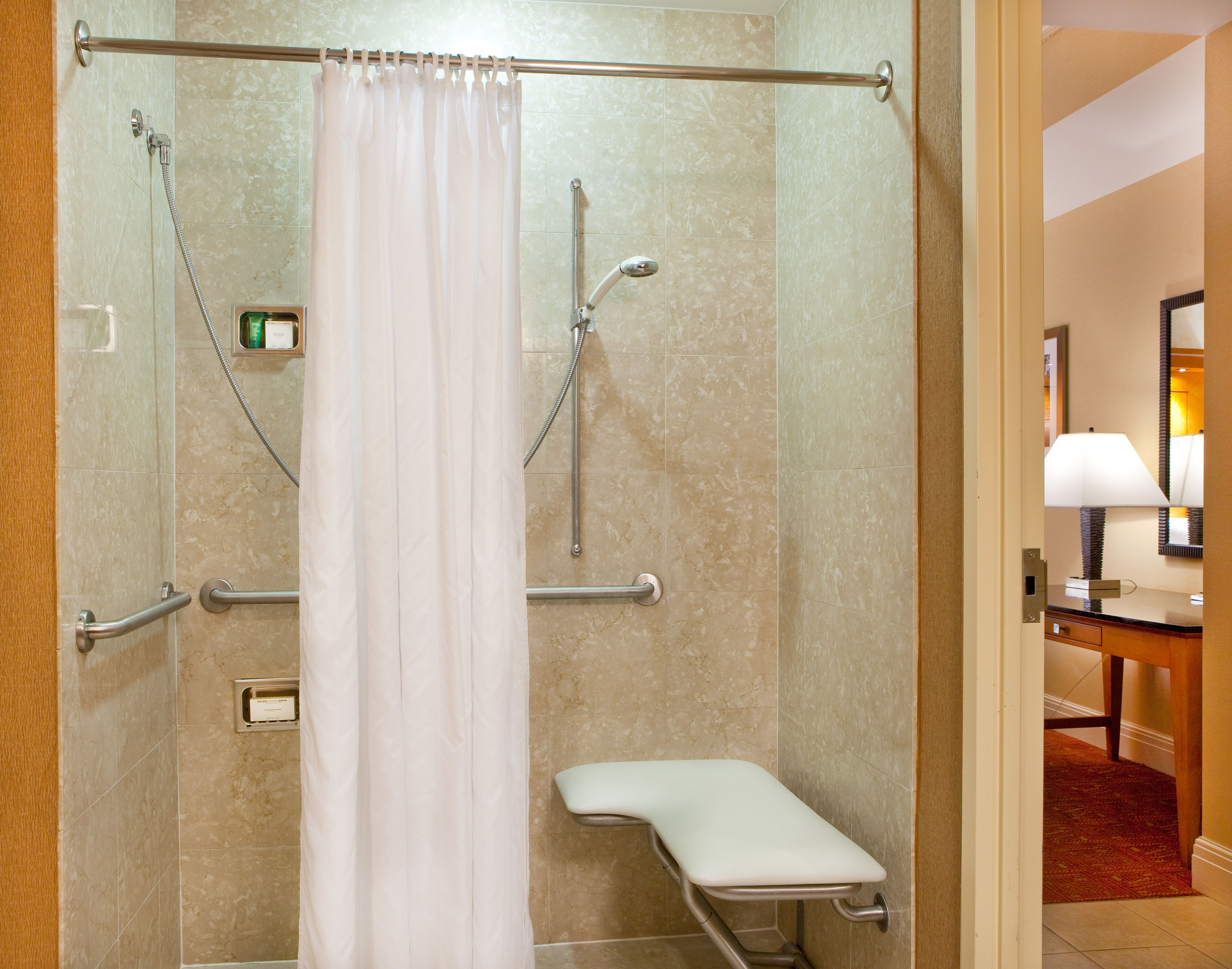 Indulge in first-class amenities in a spacious, ADA accessible layout in our distinctive guest rooms equipped with either accessible tubs or roll-in showers.