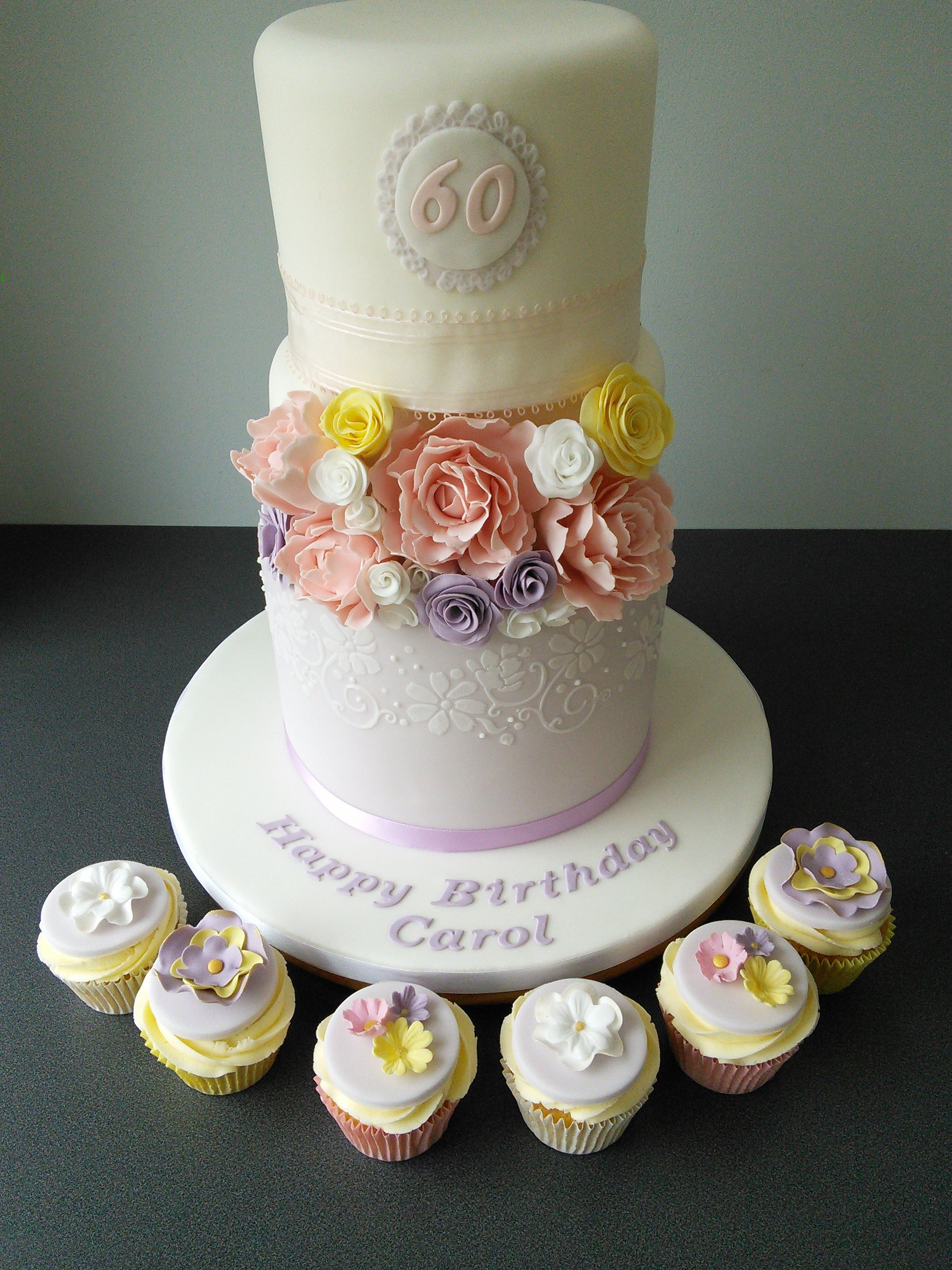 2 Tier 60th Birthday Cake With Lilac And Lace Flowers Matching Flowery Cupcakes