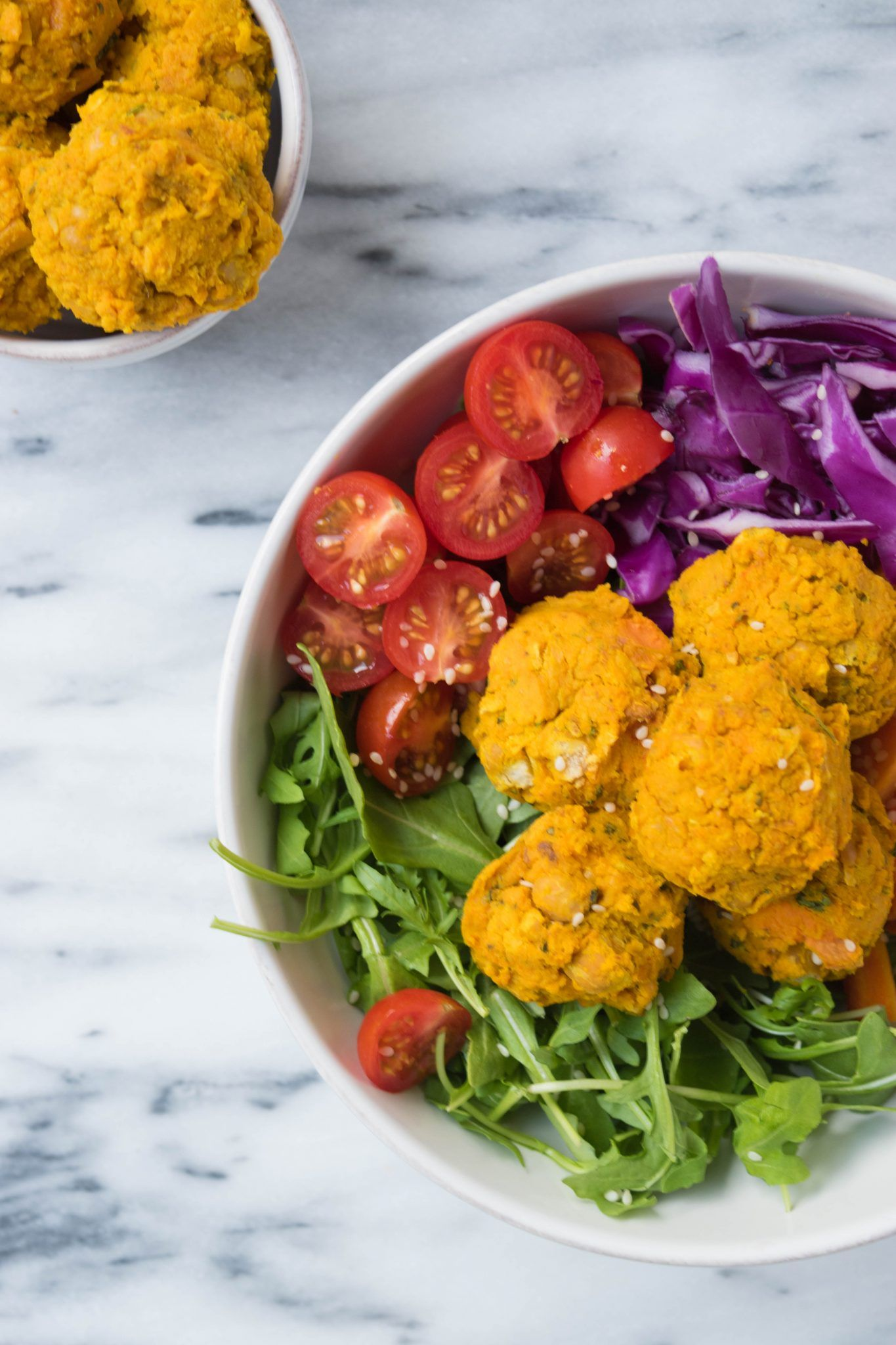 THIS feel-good vegan and gluten-free 10-Ingredient Sweet Potato Falafel recipe is the best. SO easy to throw together and tastes just heavenly. The falafels are baked, not fried and come backed with zesty spices and a pop of color.