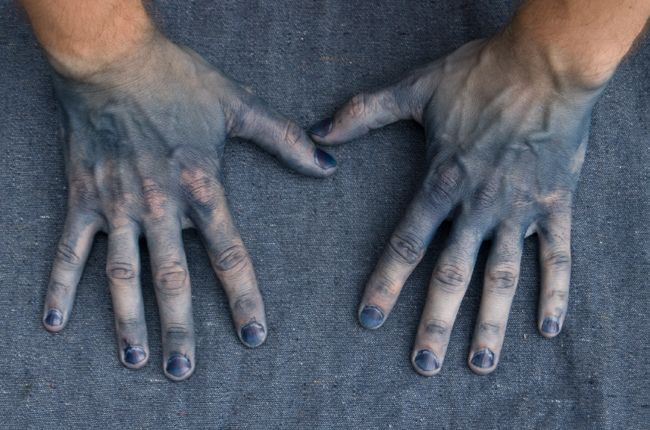 hands stained with dye