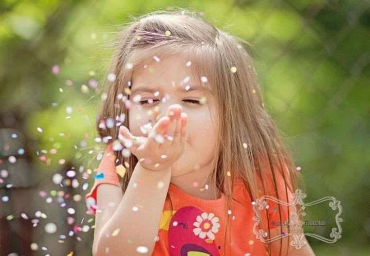 Image result for people blowing confetti