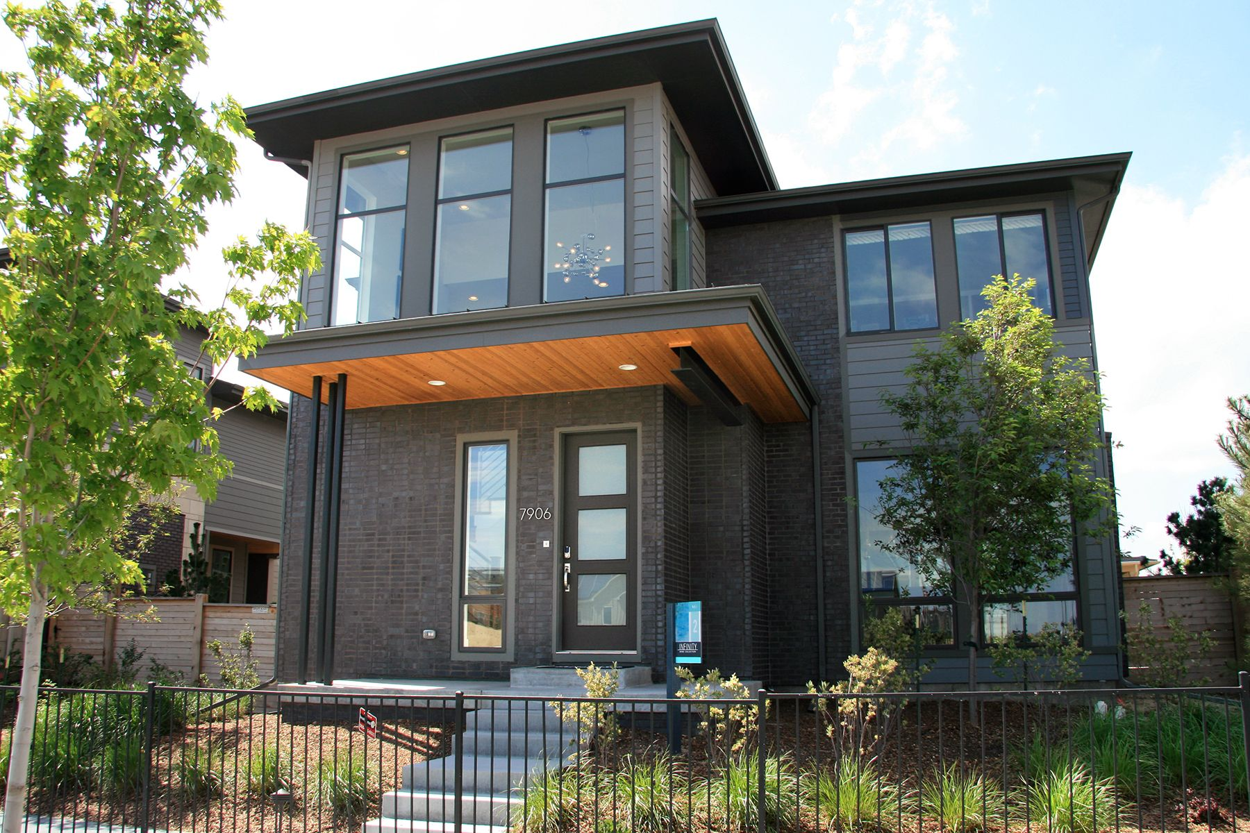 Summit brick company black diamond brick on modern homes at the vue at stapleton denver co clean monochromatic dark brick with sheen