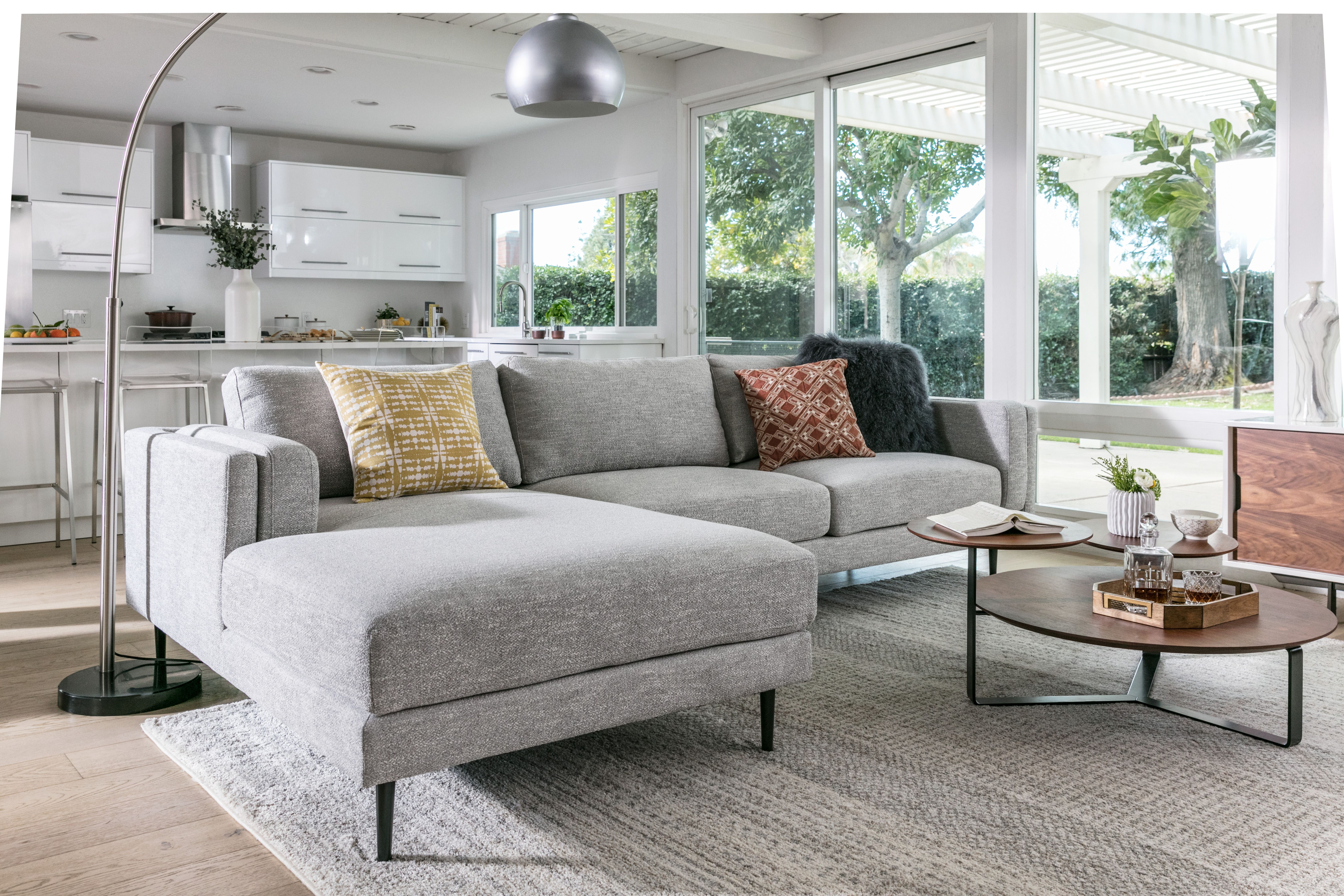 Mid Century Style Light Grey Sectional Sofa From Lean And Lofty Tapered Legs To A Squared O Gray Sectional Living Room Living Room Sectional Living Room Grey