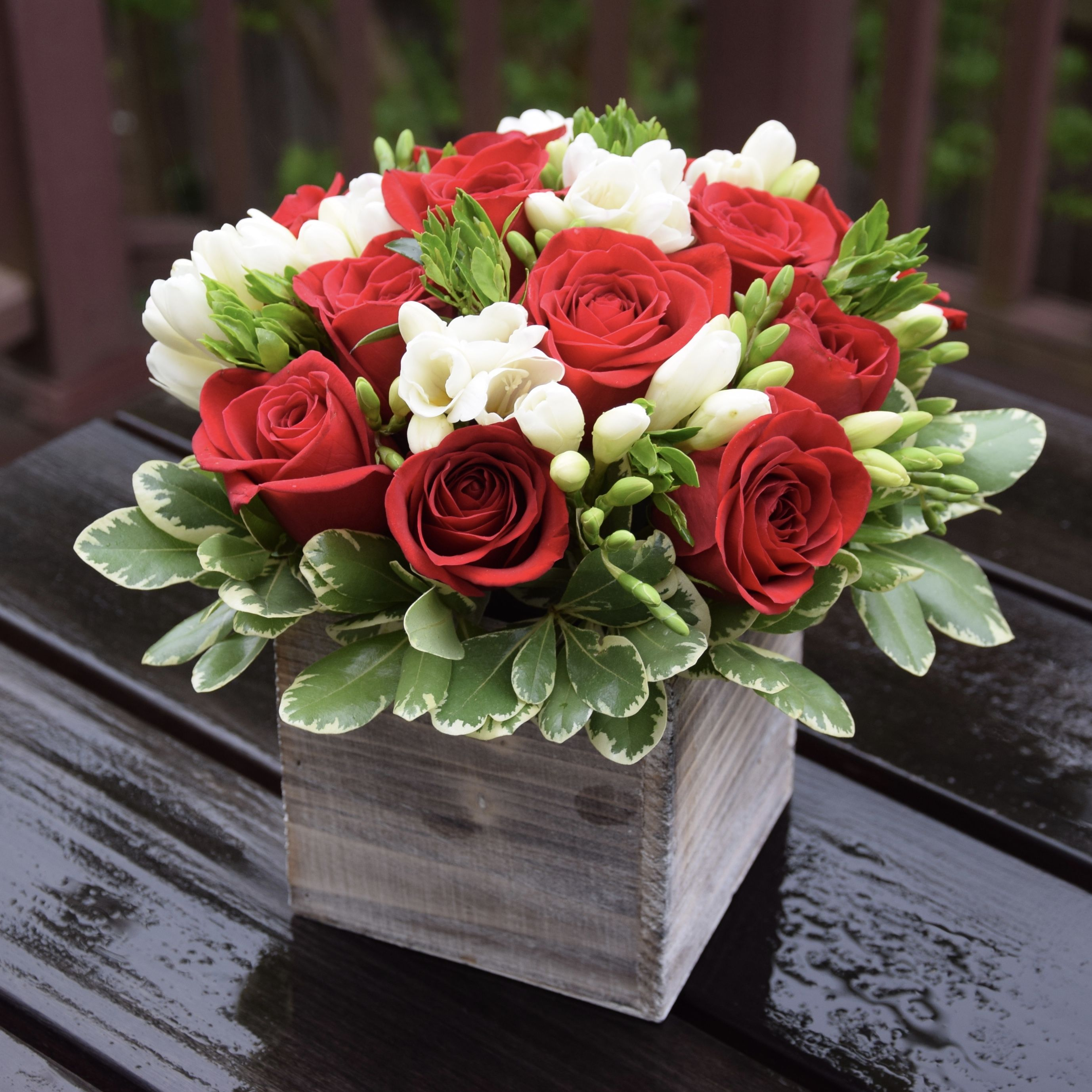 Flower Bouquet In A Rustic Container With Roses Freesias And Pittosporum Fresh Flowers Arrangements Flower Arrangements Floral Arrangements