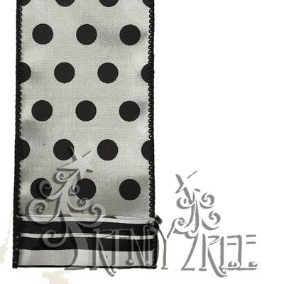 "Two Sided Polka Dot & Striped Ribbon Size: 2.5"" width; 10 yards length Color: Black, White Material: Synthetic Wire Edge One side is white satin with black dots; other side is black and"