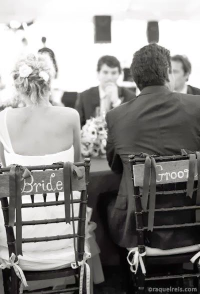 Mr. and Mrs. signs for seats :) or Bride and Groom