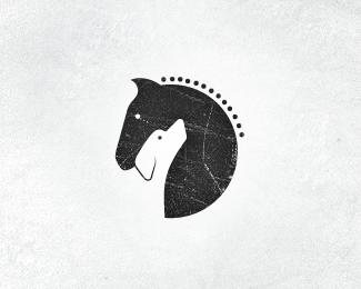 logo for horse stables & dog training center Negative