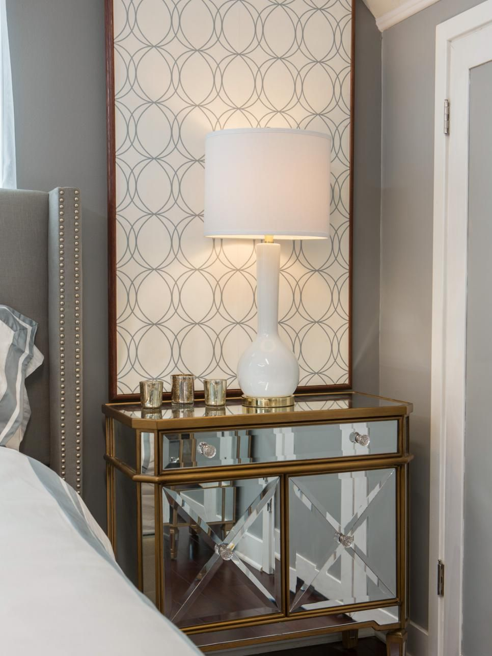 A mirrored night stand and oversized wall art accent this modern