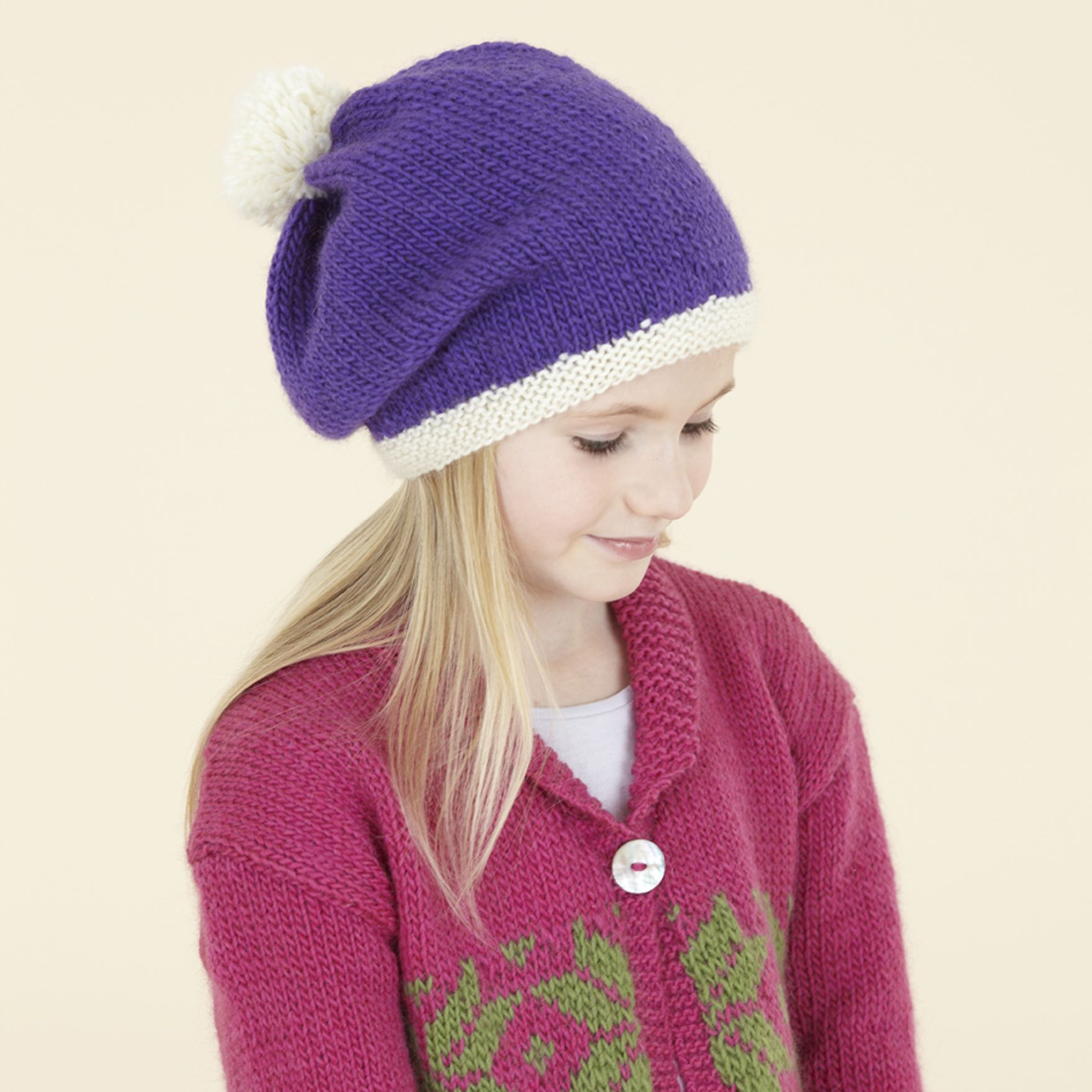 The Little London Girl Slouchy hat in Sublime Monty purple. Modern Aran hand knits in gorgeous colours.
