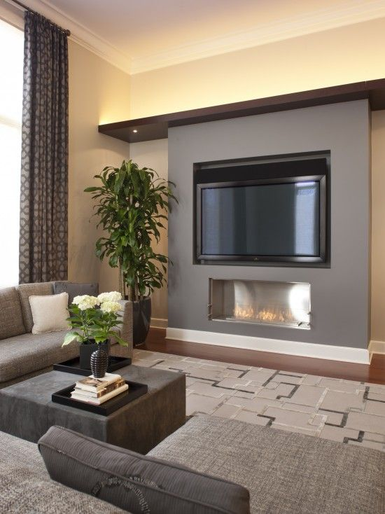 Handsome Fireplace Tv With Recessed Lighting Creates Warmth Without Clutter Contemporary Family Rooms Family Room Design Modern Family Rooms