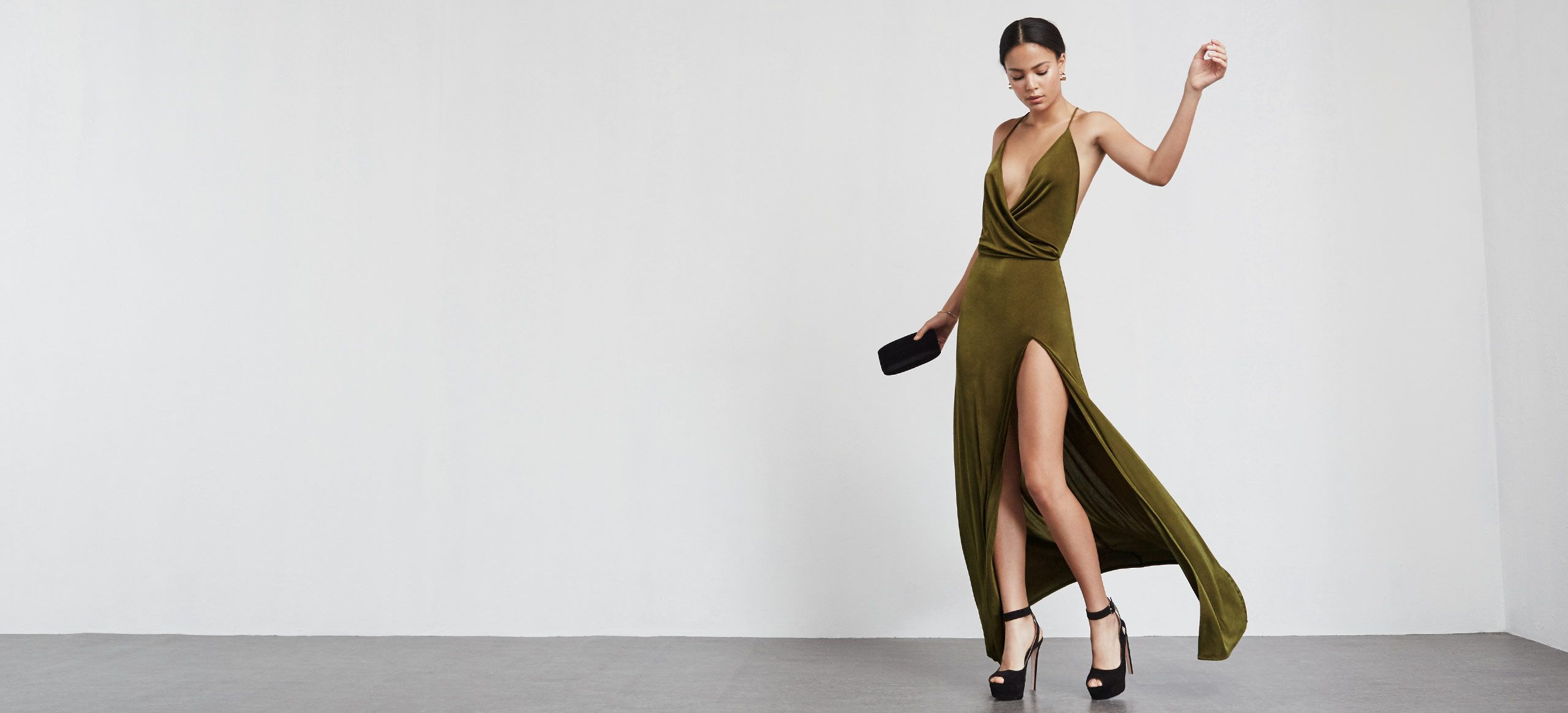 This is part of the Reformation x 4th and Bleeker NYE collection. The Martini Dress is a slinky, stretch matte jersey maxi dress with a plunging wrap neckline that drapes along the chest. High front slit, open back with criss cross straps. Fitted through the elastic waist and down the skirt, skims the body in all the right places. Made from surplus fabric.