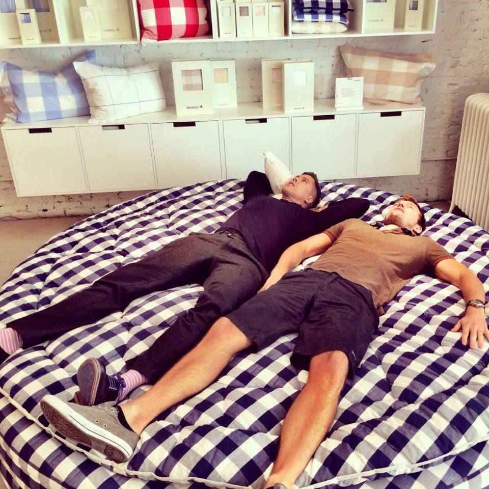 fredrik eklund and his husband testing a hastens bed in ny http
