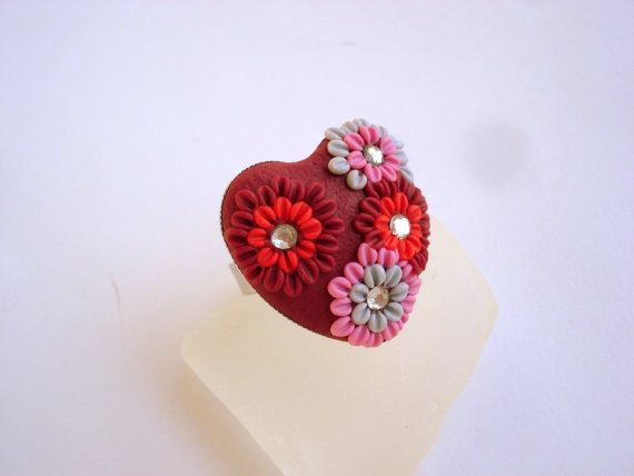 I made this adjustable ring from polymer clay in filigree technique. The ring came with free gift- delicate post earrings.    My Shop: