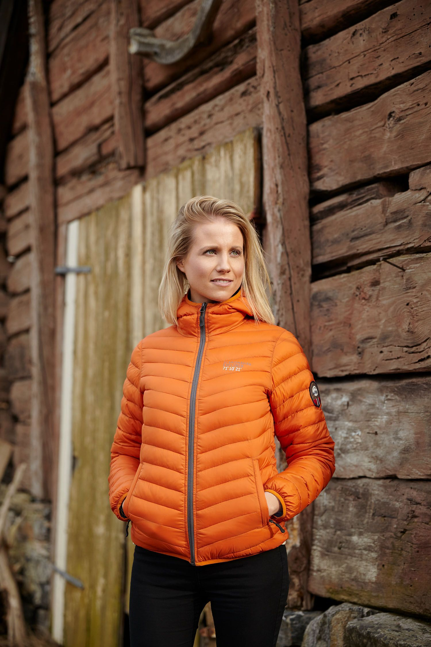 The Rusty Orange Down Jacket My Scandinavian Explorer Is Tailored To The Changing Climate Of Norway