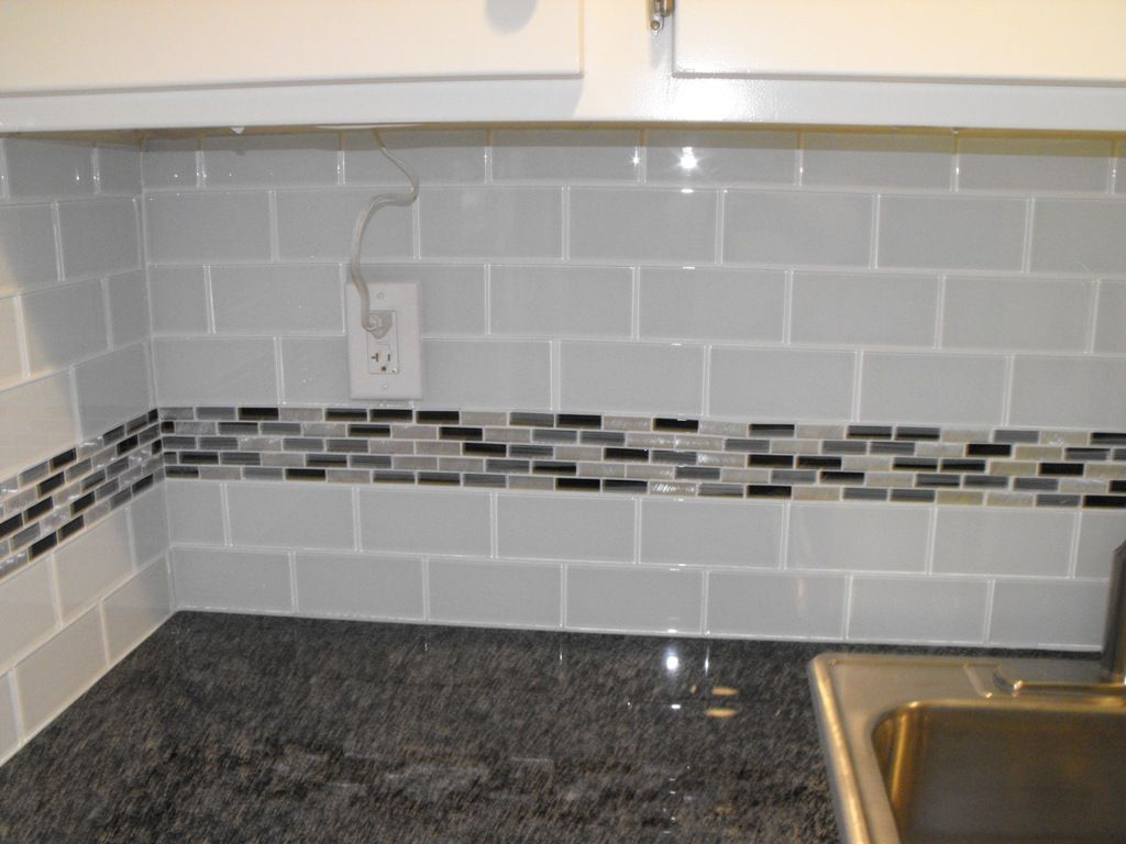 22 light grey subway white grout with decorative line of mosaic tiles running through Backsplash mosaic tile