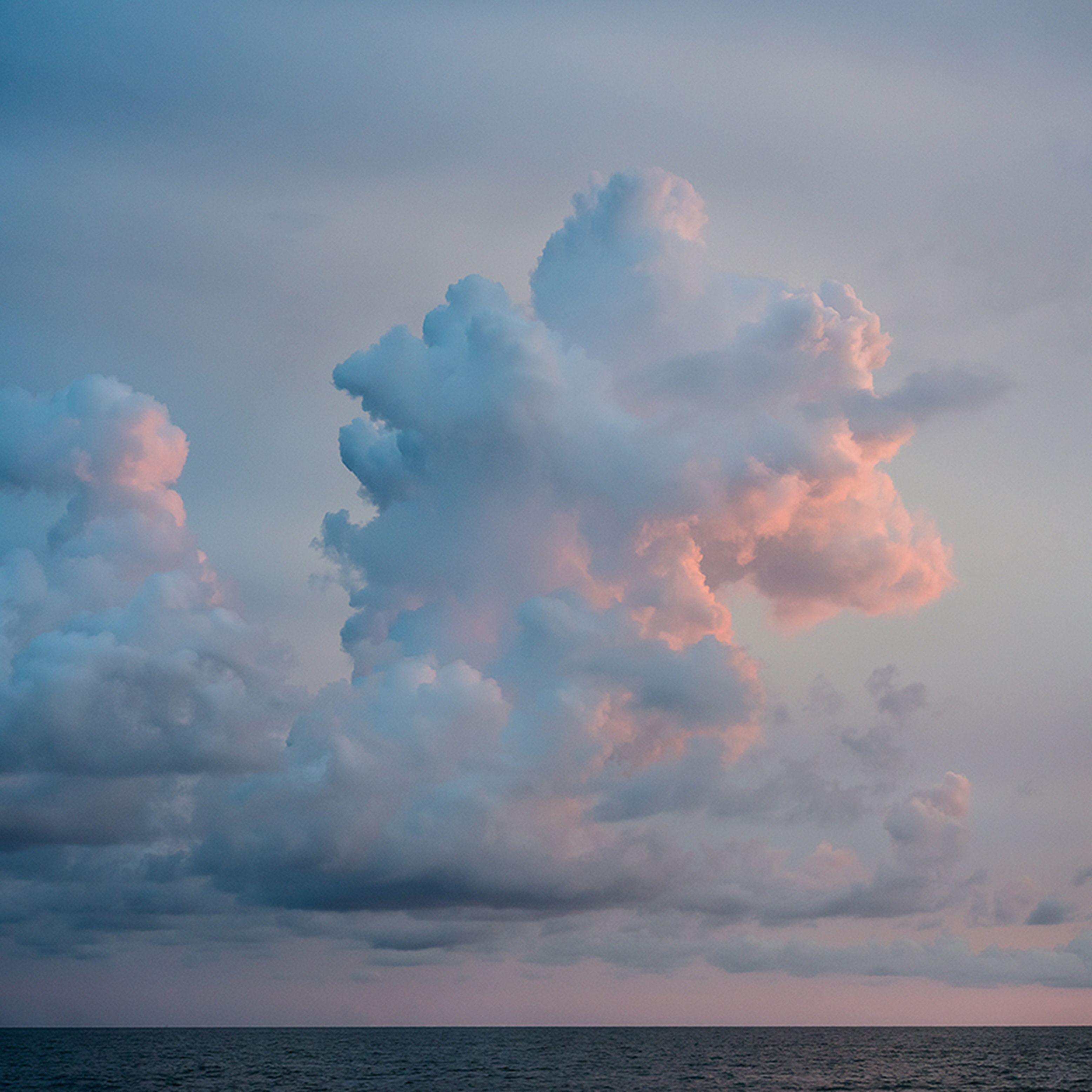 Contemplation 2, Captiva by Sloane Siklos, Photograph, 20.8 x 20.8  ::  This is a peaceful image of a sunset over the gulf of Mexico, taken from Captiva Island in Florida. The sunset clouds are coloured pale pink and orange, and seem to form the shape of a unicorn in the sky.     This is a photographic C print on Fuji paper. The image measures 20.75 x 20.75 on 24 x 24 in paper. A white border surrounds the image. This is an artist proof at this size. The image is available in additional sizes up