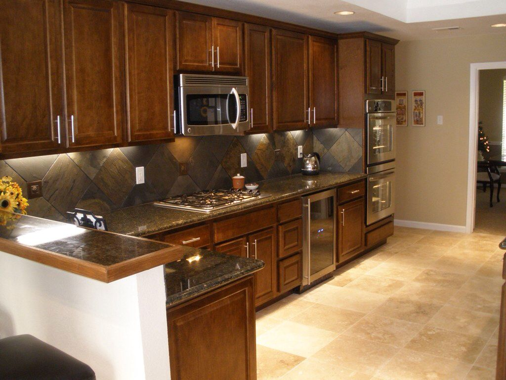 The Right Tile And Granite Combination Slate Backsplash Dark Granite Kitchen Tile Design Kitchen Backsplash Tile Designs Bamboo Kitchen Cabinets Backsplash
