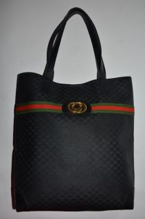 e954ecd0260 Authentic vintage Gucci golden GG medallion tote in black made in 80s. Black  GG canvas