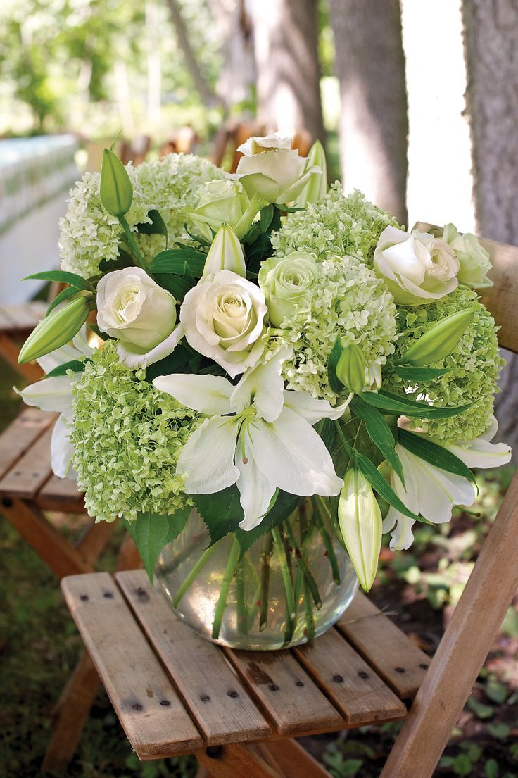 Flower Arrangement Of White Roses And Lilies And Green Hydrangea