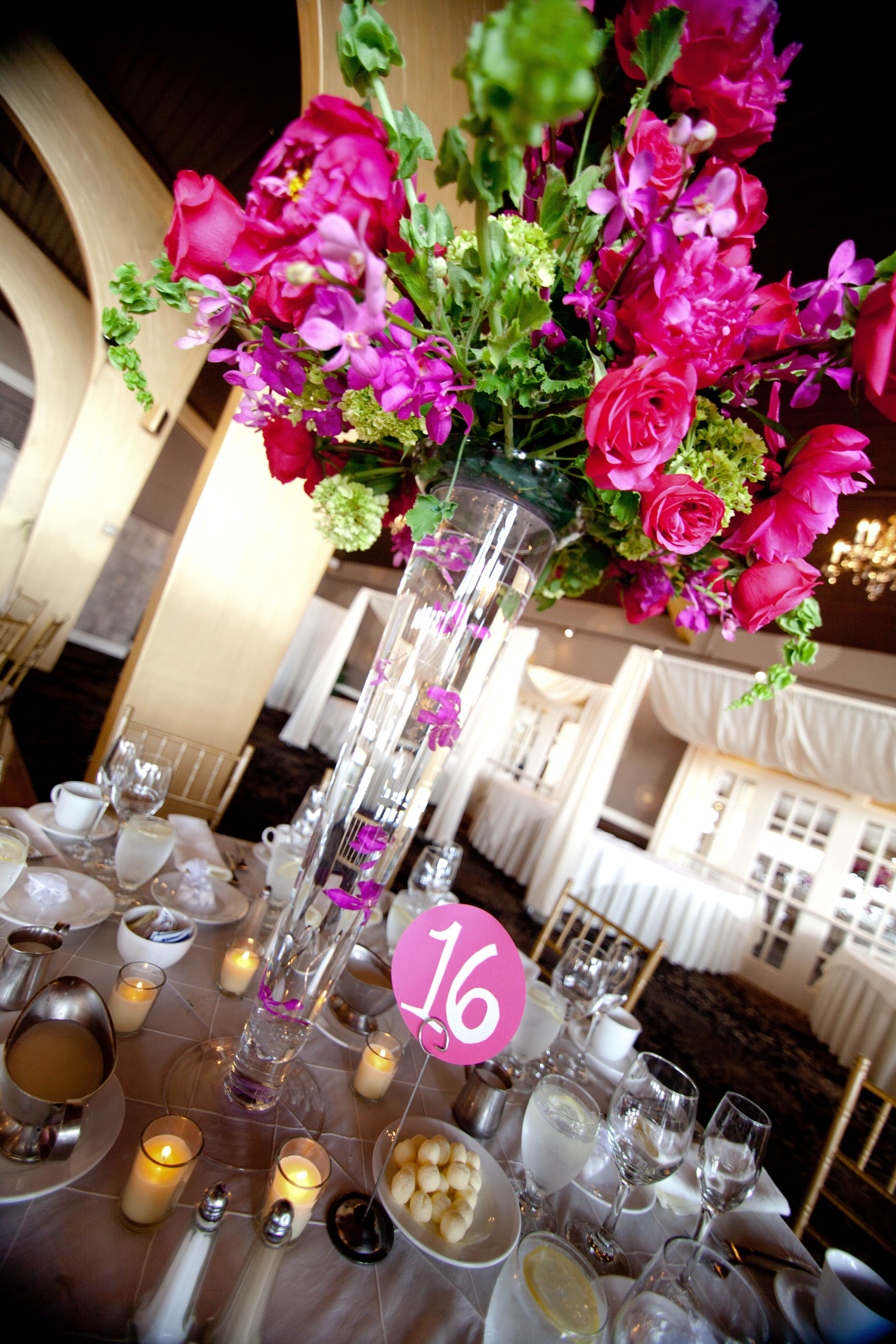Tall Centerpiece With Hot Pink Flowers And Accent Of Green Using