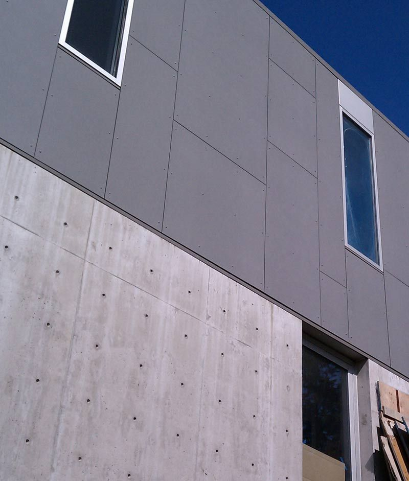 Cement Panels Building Exteriors : Swiss pearl cementitious panel installed at concrete wall