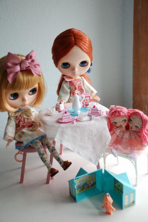 mini kewpie, mini dollhouse, and a two-headed rag doll