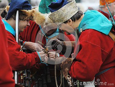RUSSIA, MOLODI VILLAGE - JULY 27: Unidentified people in retro costume is Ignition wicks on event dedicated to Victory in battle near the Molodi village 1572, on July 27, 2013, in Moscow region, Russia Поджечь фитили