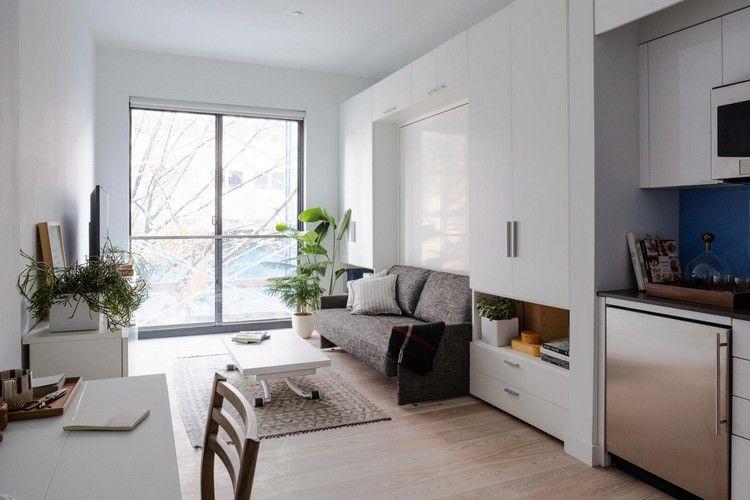 idée aménagement studio, rangements intégrés blanc laqué, table ...