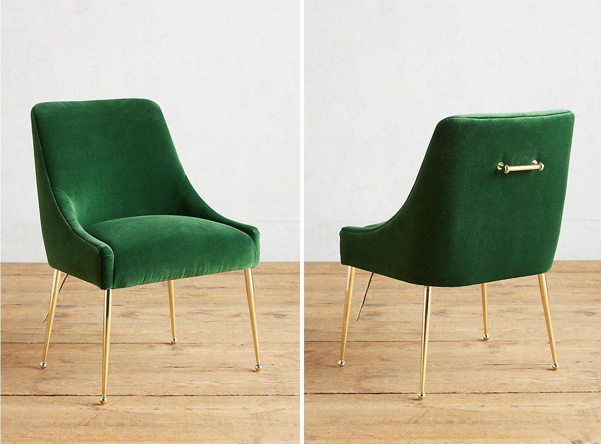 Green velvet chair with polished brass legs and a back handle