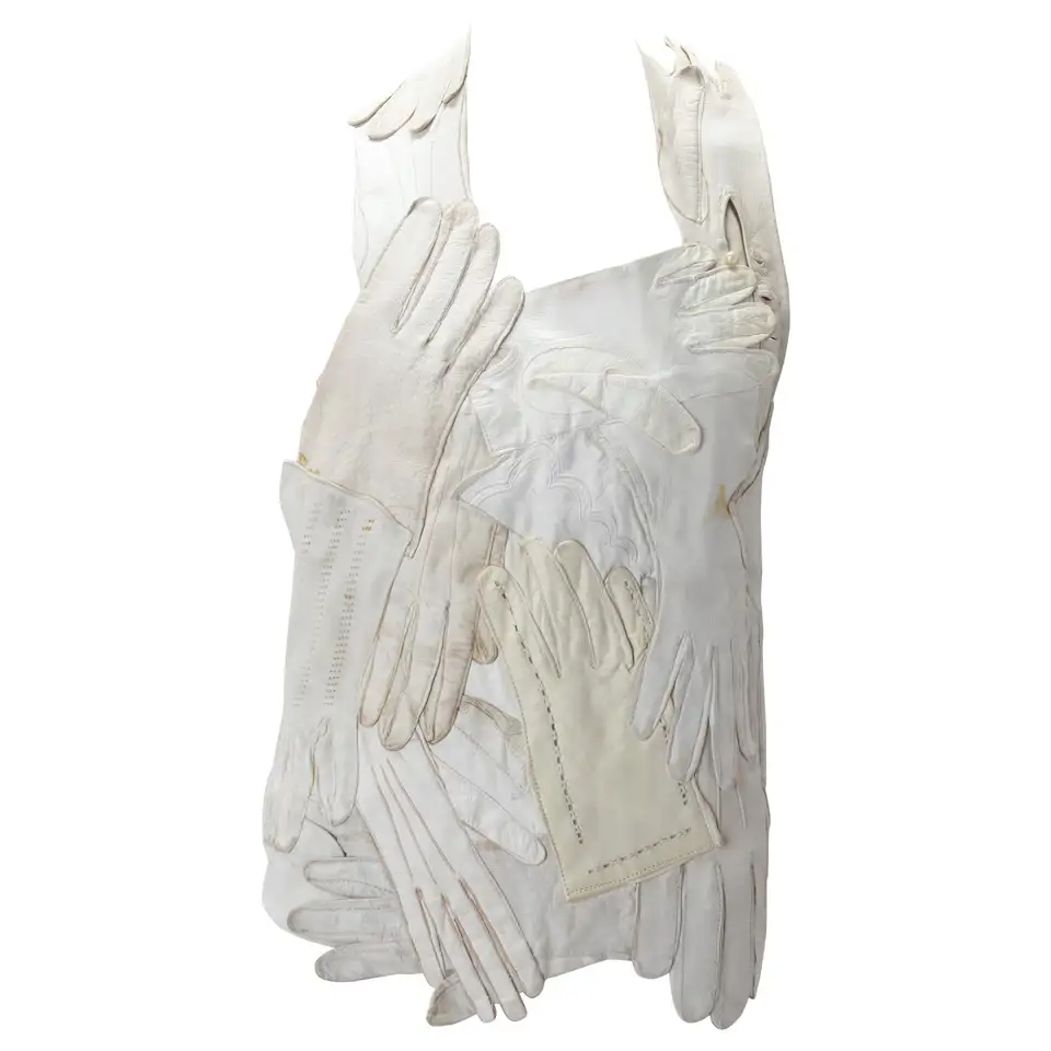 View this item and discover similar for sale at 1stdibs - Iconic Maison Martin Margiela Artisanal White Glove Bodice, S/S 2001. Maison Martin Margiela halter neck bodice that is made entirely of a collage of cream/ivory/white